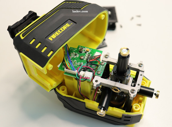 Disassembled laser level Firecore F94T-XG