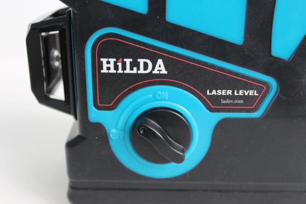 Поворотный тумблер включения у laser level HILDA 3D.