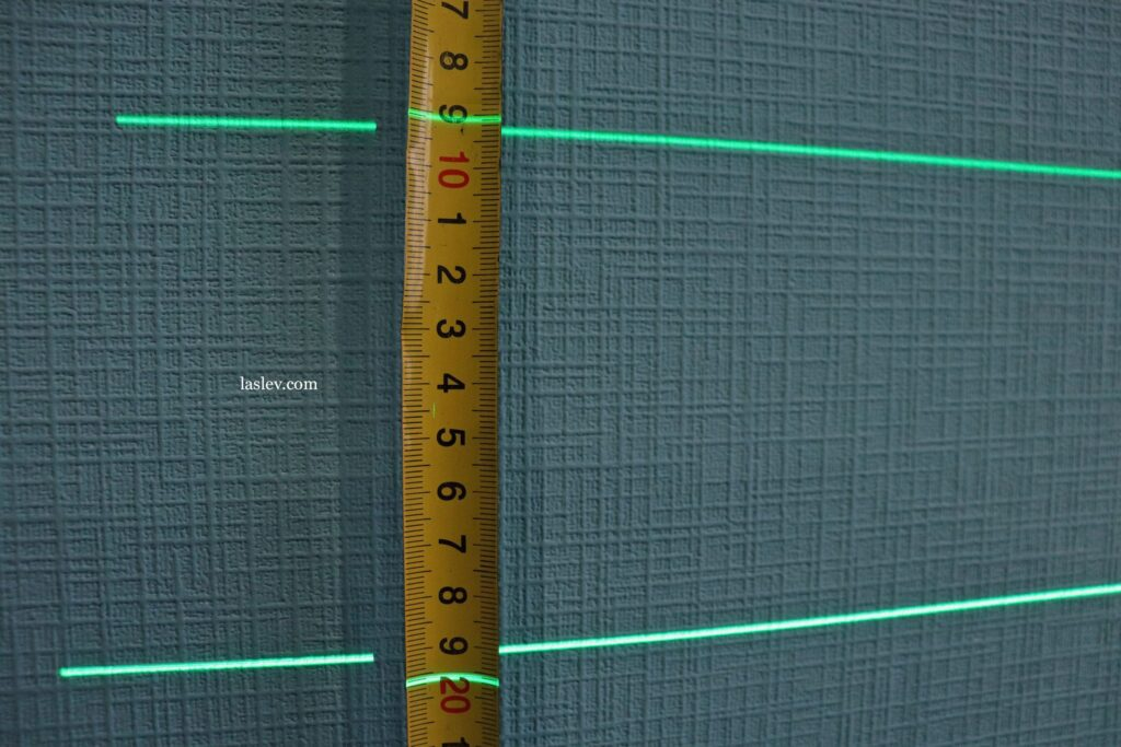 The thickness of the laser line at a distance of one meter.