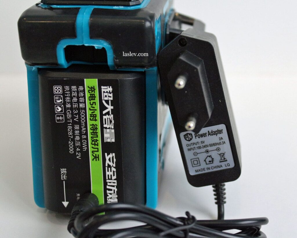 laser level HILDA 3D LS055 with plugged-in power adapter.