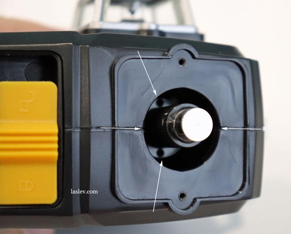 Bolts responsible for calibrating the DEKO DKLL12PB1 laser level.