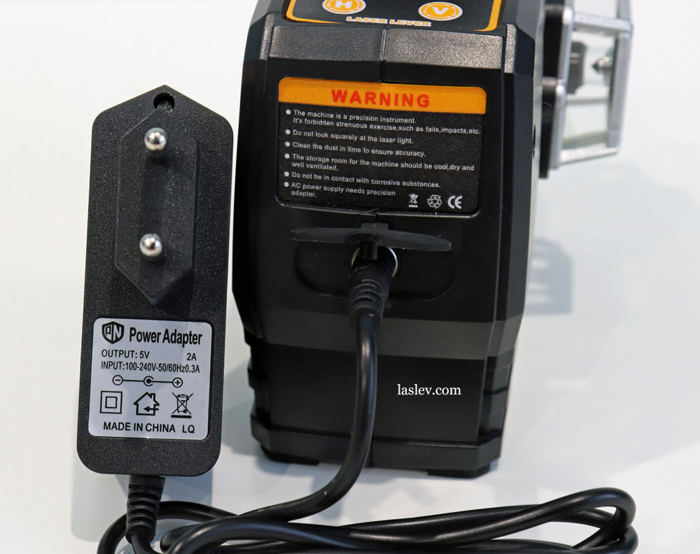 Connect the charger to the DEKO DKLL12PB1 laser level.