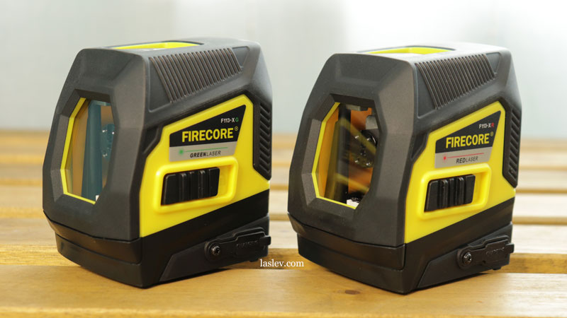 Two laser levels Firecore F113XG with green laser and Firecore F113XR with red beam.