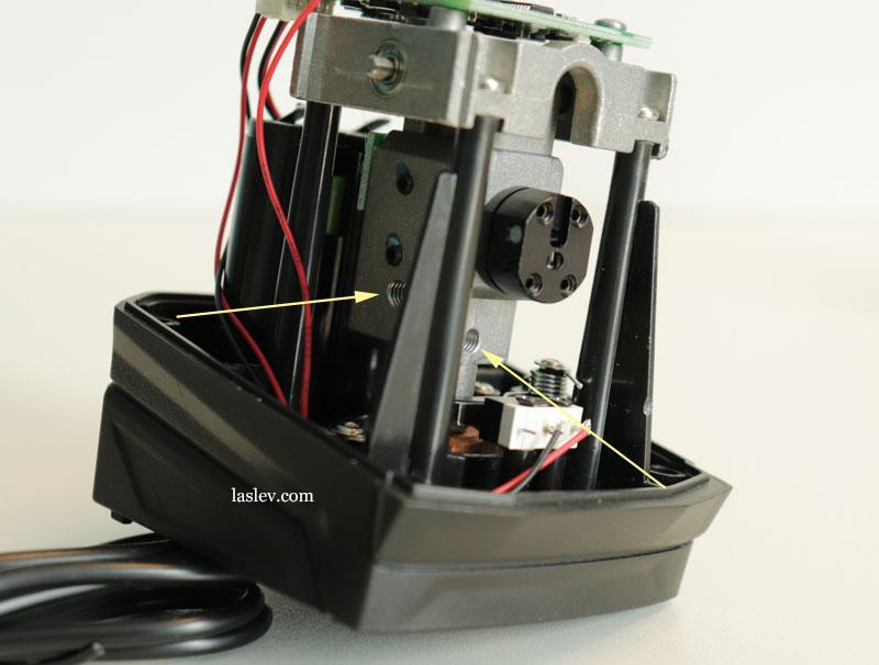 Threaded bolt holes in the Firecore F113XG (XR) laser level pendulum.