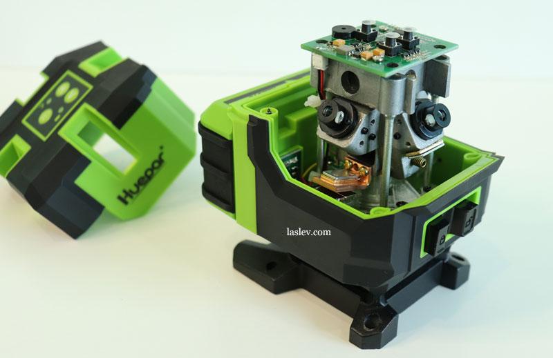 Metal frame inside the Huepar LS41G laser level on which the compensator is mounted.